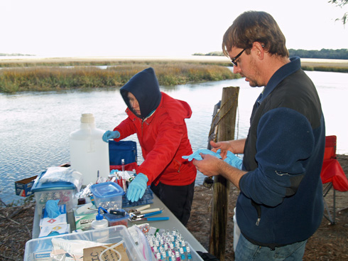 Thais Bittar and Zac Tait begin to process the water sample.