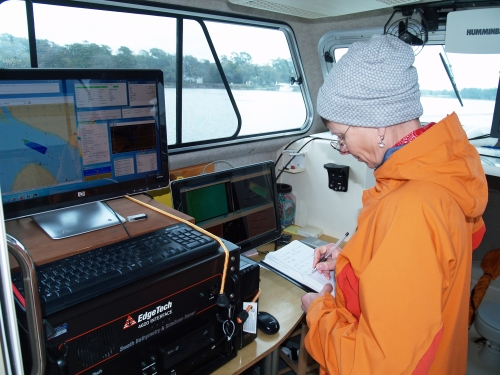 Skidaway Institute of Oceanography research coordinator Claudia Venherm logs survey activity on board the R/V Jack Blanton.
