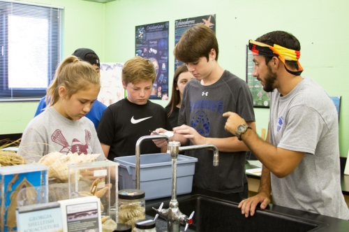 St. Andrews' students receive close instruction from teacher Nick DeProspero (right).