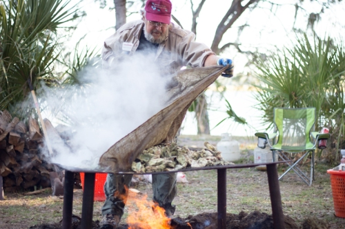 "John ""Crawfish"" Crawford cooks a  batch of oysters."